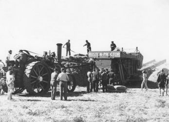 Traction engine and threshing mill